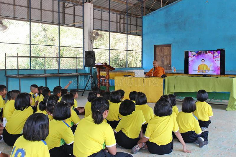 The way of eradicate sorrow. UDONTHANI, THAILAND – SEPTEMBER 4, 2018: Primary students be listening about the way of eradicate sorrow from Buddhist monk royalty free stock photo