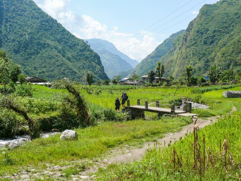 Way between fields to Tatopani, Nepal royalty free stock images