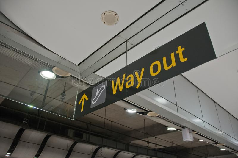 Way out emergency evacuation exit sign arrow direction. In the train station royalty free stock images