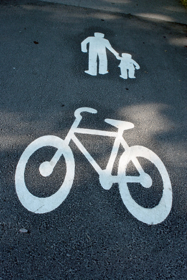Way for pedestrians and bikes. Way for pedestrians and bicycles - painted signs on asphalt royalty free stock images