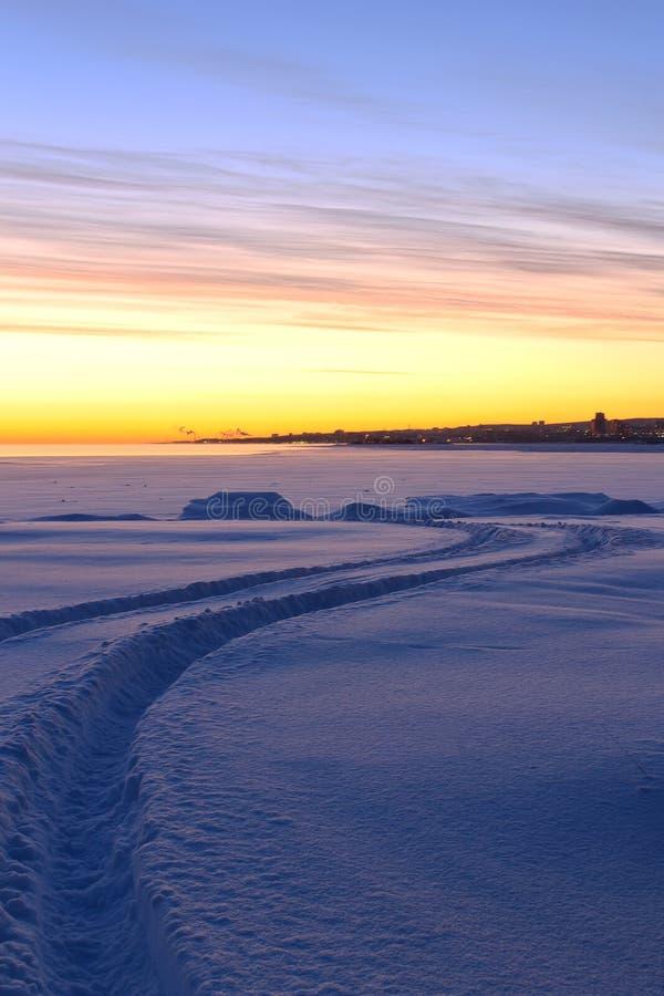 A way among the snow under colorful dawning sky. Karelia, Russia stock photography