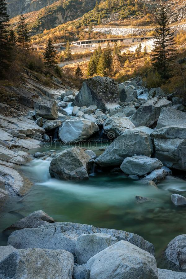 River coming from the mountains. ON the way to Gotthard pass ,there are many waterfalls and creeks ,amazing colors and shapes royalty free stock images