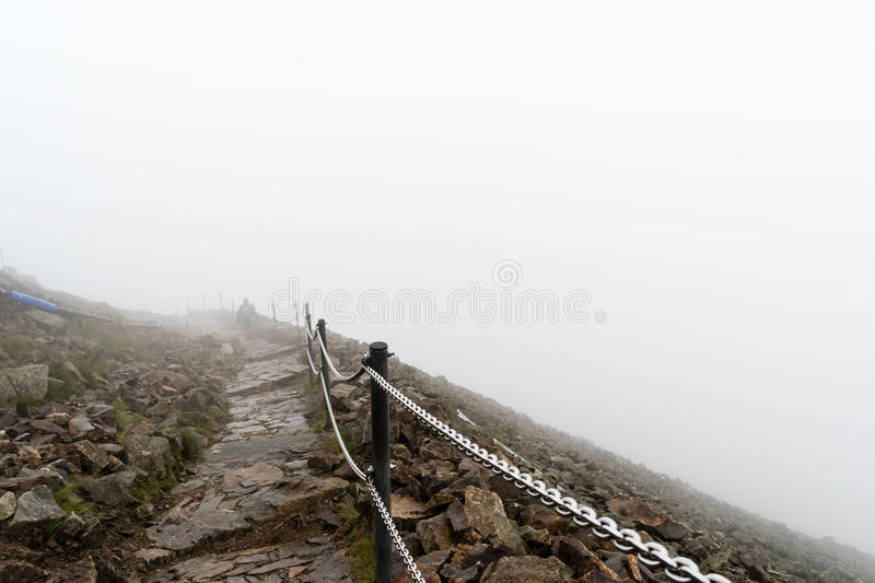 The way to the highest mountain in Krkonose National Park. Snezka. Foggy, windy and wet weather, the view of the ridge lost in cloud stock photography