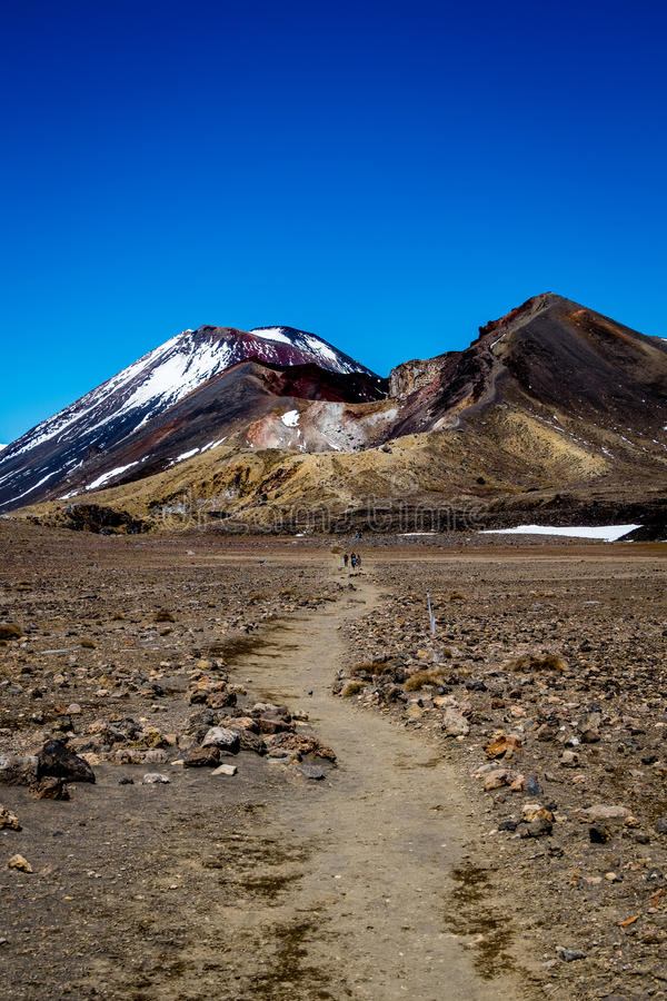 Way to the mordor - Mt Ngaruhoe, Tongariro Alpine Crossing. Mt Ngaruhoe - Mount Ngauruhoe was used as a stand-in for the fictional Mount Doom in Peter Jackson`s stock image