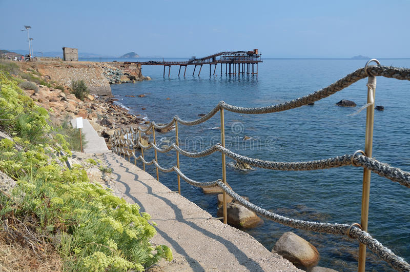 Way to the old pier in Rio Marina. royalty free stock image