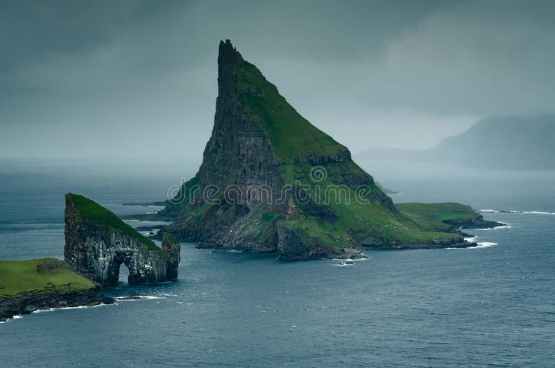 On the way to one of the most famous places in the Faroe Islands, the Drangarnir rock formation with the iconic hole in the cliff stock images
