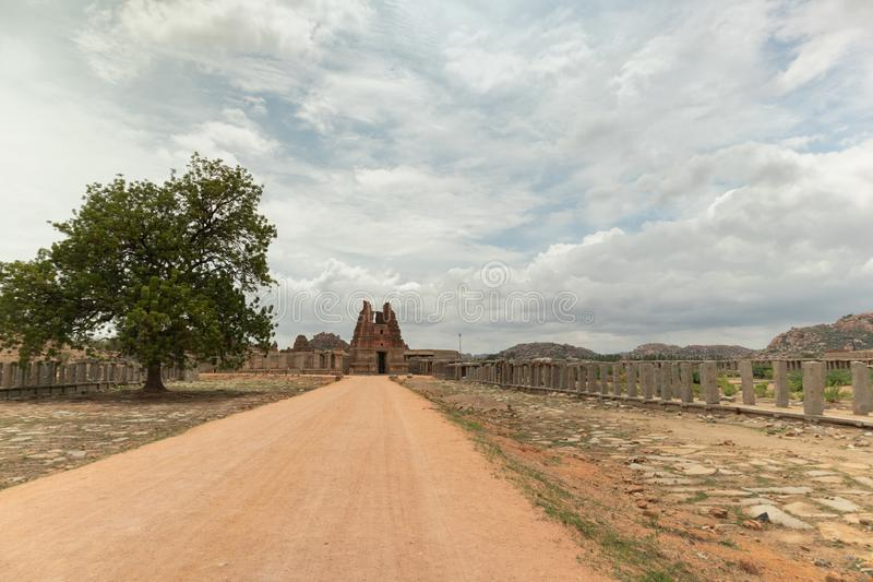 Way to Ruined Vittala Temple complex and stone Chariot at Hampi, India.  royalty free stock photo