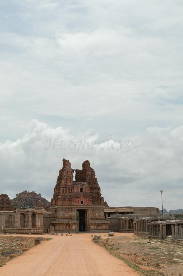 Way to Ruined Vittala Temple complex and stone Chariot at Hampi, India.  stock photo