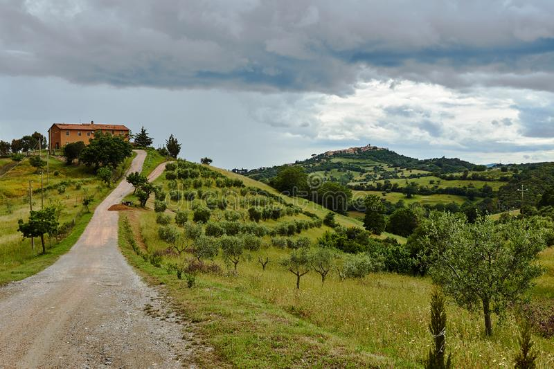The way to a rural house on a hill stock photos
