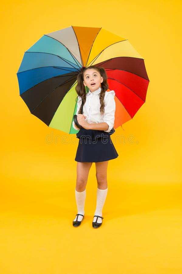 On way to school. Fashion accessory. Rainy september. Accessory for rainy day. Fancy schoolgirl. Girl with umbrella. Rainy day. Happy childhood. Kid happy with royalty free stock photography