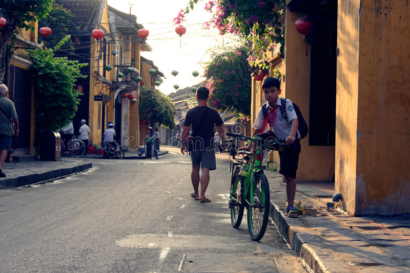 On The Way To School In Hoi An. A child riding his bike to school in Hoi An, Vietnam stock photography
