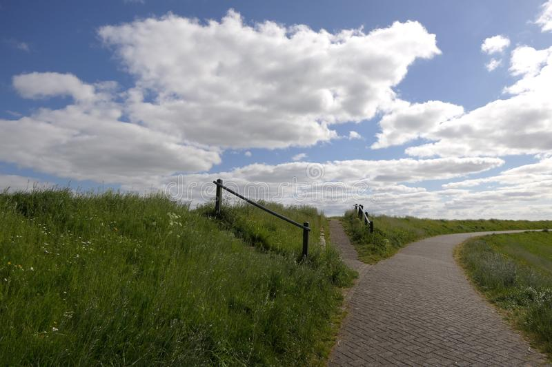 Way up to the Wadden Sea Dike royalty free stock images
