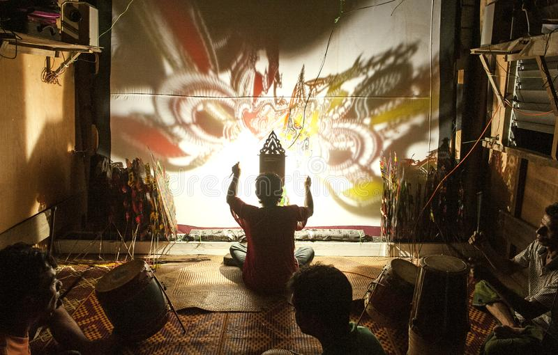 WAYANG KULIT SHADOW PUPPETRY - KELANTAN. Shadow play which is also known as shadow puppetry is an ancient form of storytelling and entertainment which uses flat stock photos