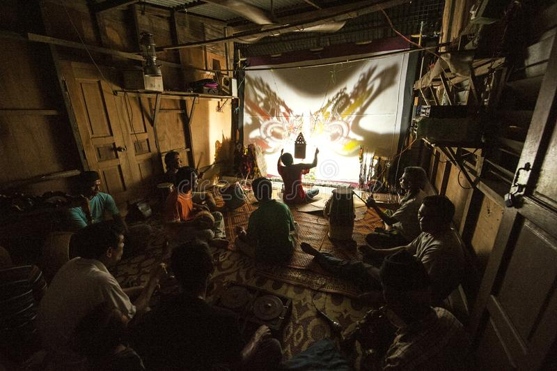 WAYANG KULIT SHADOW PUPPETRY - KELANTAN. Shadow play which is also known as shadow puppetry is an ancient form of storytelling and entertainment which uses flat stock photo