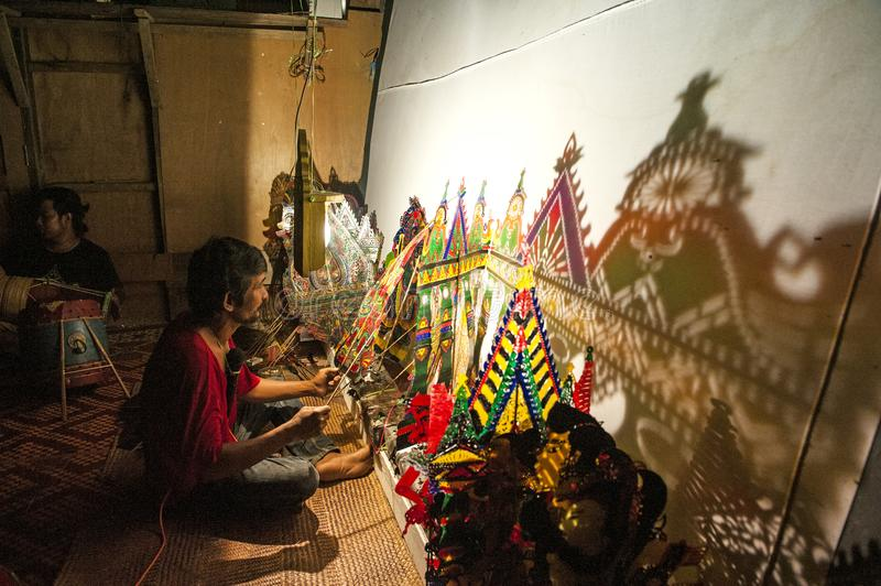 WAYANG KULIT SHADOW PUPPETRY - KELANTAN. Shadow play which is also known as shadow puppetry is an ancient form of storytelling and entertainment which uses flat royalty free stock photography