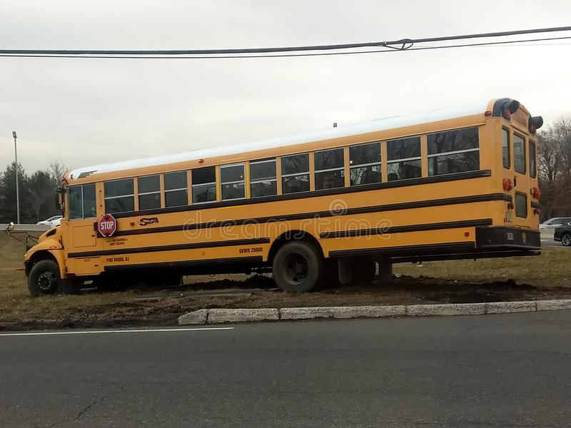 Wayne, New Jersey, United States - March 14, 2019: School bus misses turn and drives off the road. The bus needed to be towed. Wayne new jersey united states stock images