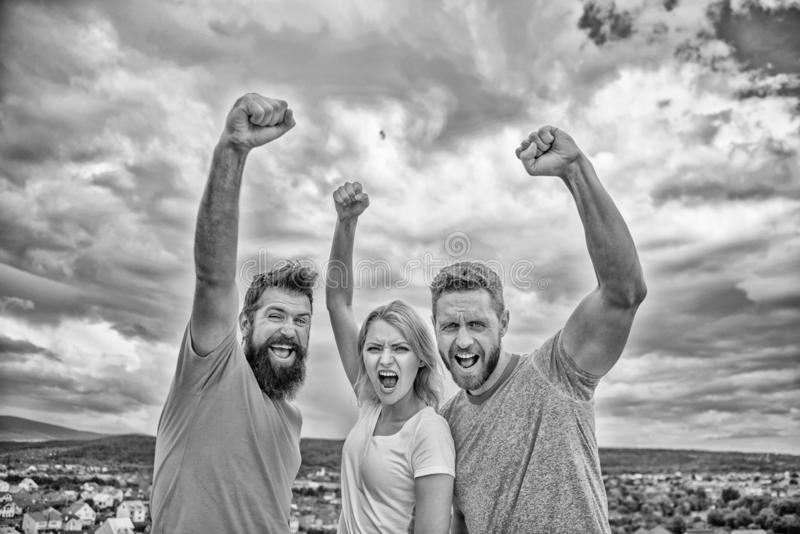 Ways to build ohesive team. Woman and men look confident successful sky background. Threesome stand happy confidently stock image