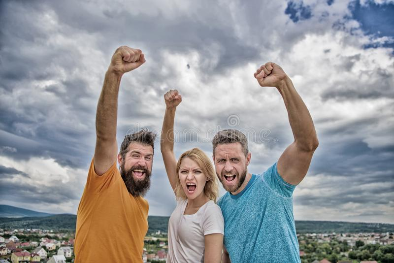 Ways to build ohesive team. Woman and men look confident successful sky background. Threesome stand happy confidently stock photography