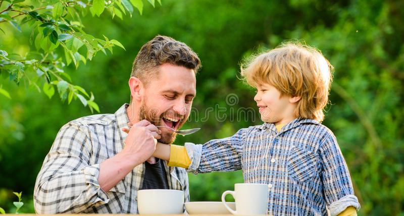 Ways to develop healthy eating habits. Feed your baby. Natural nutrition concept. Feeding son natural foods. Stage of royalty free stock images