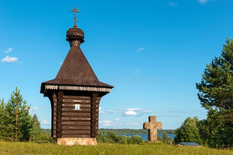 A small chapel and an old cross on a hilltop royalty free stock photography