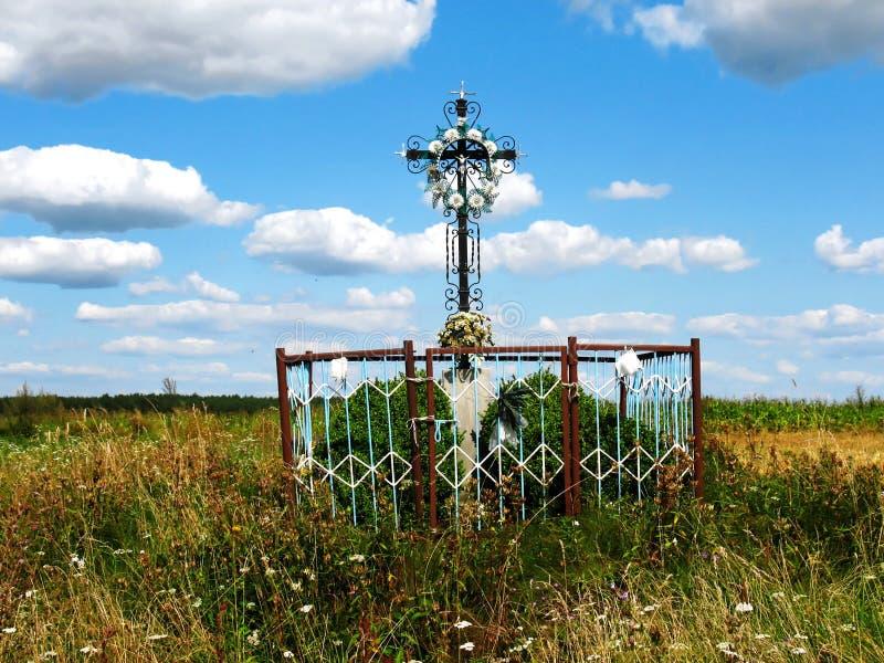 The wayside shrine. Old wayside cross with statue of Jesus Christ. Masuria, Poland royalty free stock photography