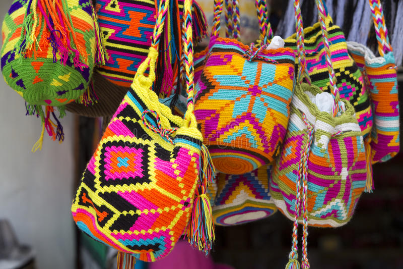 Wayuu handcrafted mochilas bags for sale in Guatape market, Colo. Women fashion accessories, Various items of crocheted bucket-style handbags, Wayuu handcrafted stock image
