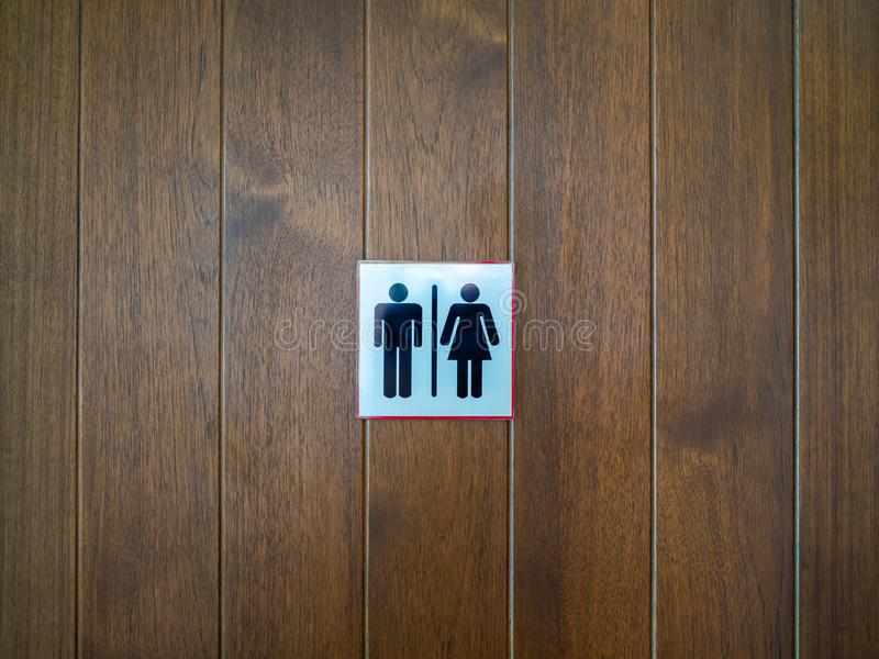 WC / Toilet sign, man and lady icon on wooden background royalty free stock images