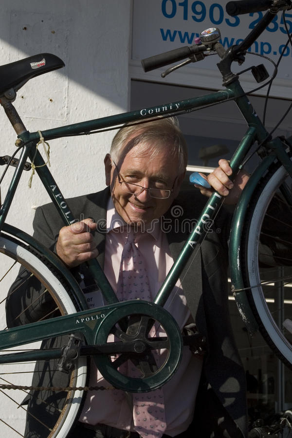 WCHP Charity Shop Opening. British Conservative MP Sir Peter James Bottomley Opening a Charity Shop (raising money for the charity) and Bicycle Recycling stock photo