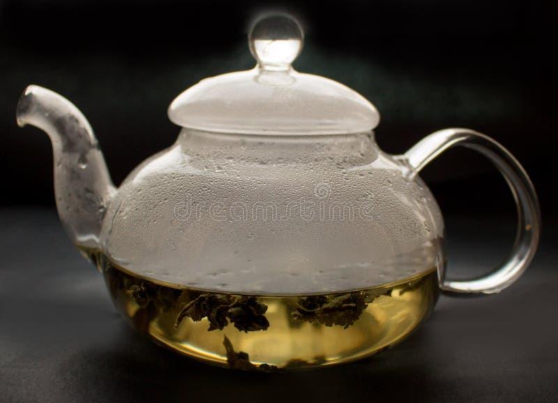 Wciąż życie, przejrzysty szklany teapot, filiżanka z herbatą, zdjęcia stock