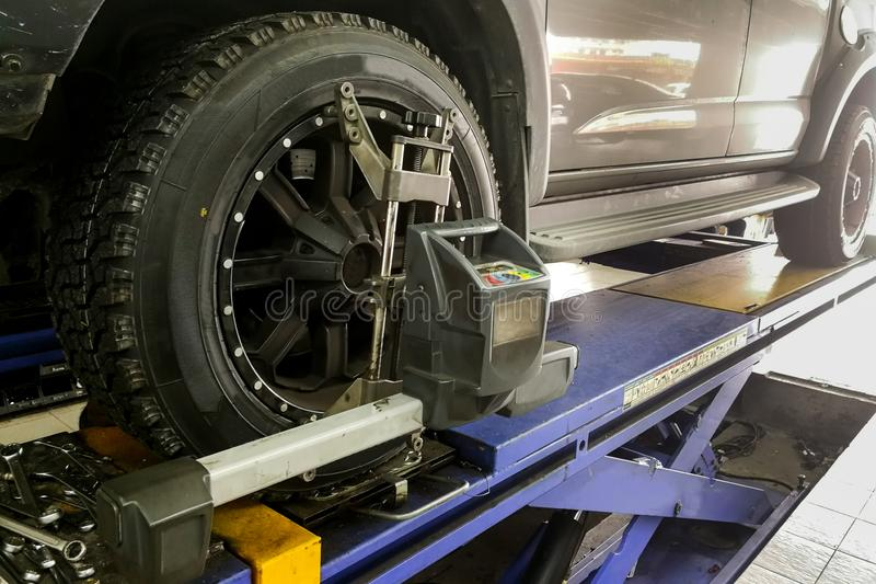 4WD car undergo wheel align in garage. With precision alignment equipment royalty free stock images