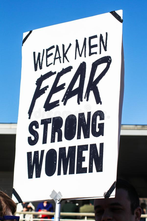 Weak Men Fear Strong Women sign at Womens March Tulsa Oklahoma USA 1-20-2018. Woman hold Weak Men Fear Strong Women sign at Womens March Tulsa Oklahoma USA 1-20 royalty free stock photography
