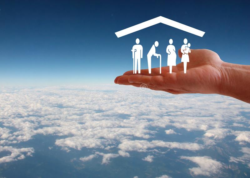 Weak social categories welfare concept with hand and roof on aerial sky view background royalty free stock photo