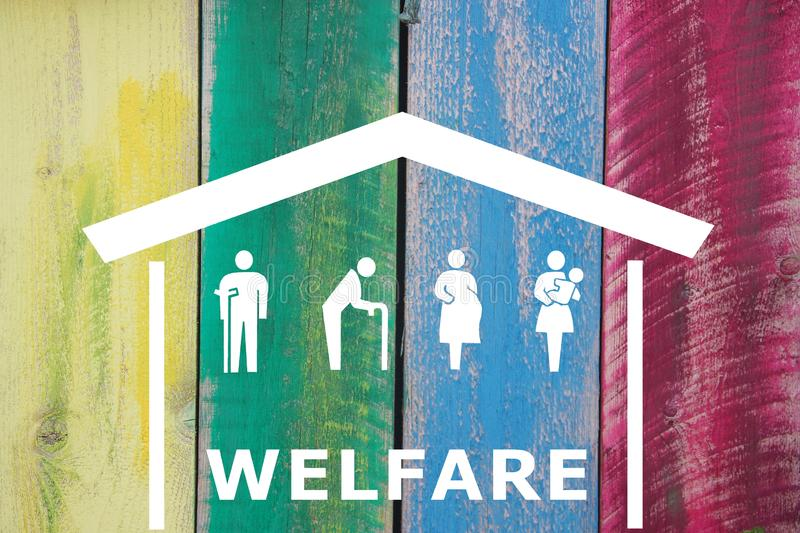 Weak social categories welfare concept with house and rooftop on wooden coloured background royalty free stock images