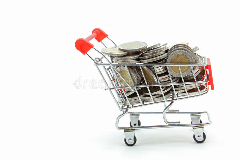 Wealth coins shopping cart. Isolated shopping cart with full wealth coins inside on white background stock images