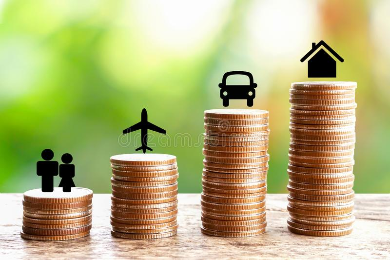 Wealth concept with stack of coin  home,car,happy couples icons. Business and finance background stock image