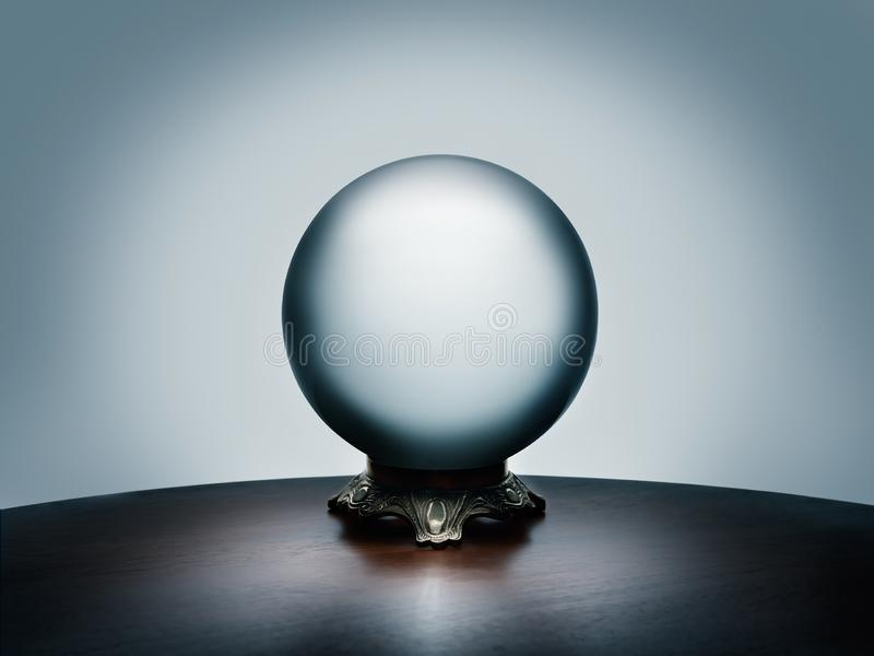 See your future in the magical crystal ball on simple dark wood table royalty free stock images