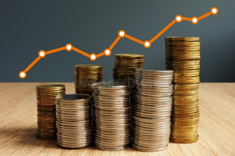 Wealth growth. Coins increase and financial chart. Business success. royalty free stock photo
