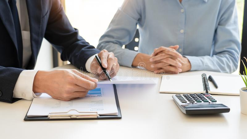 Wealth management concept, business man and team analyzing financial statement for planning financial customer case in office stock photo