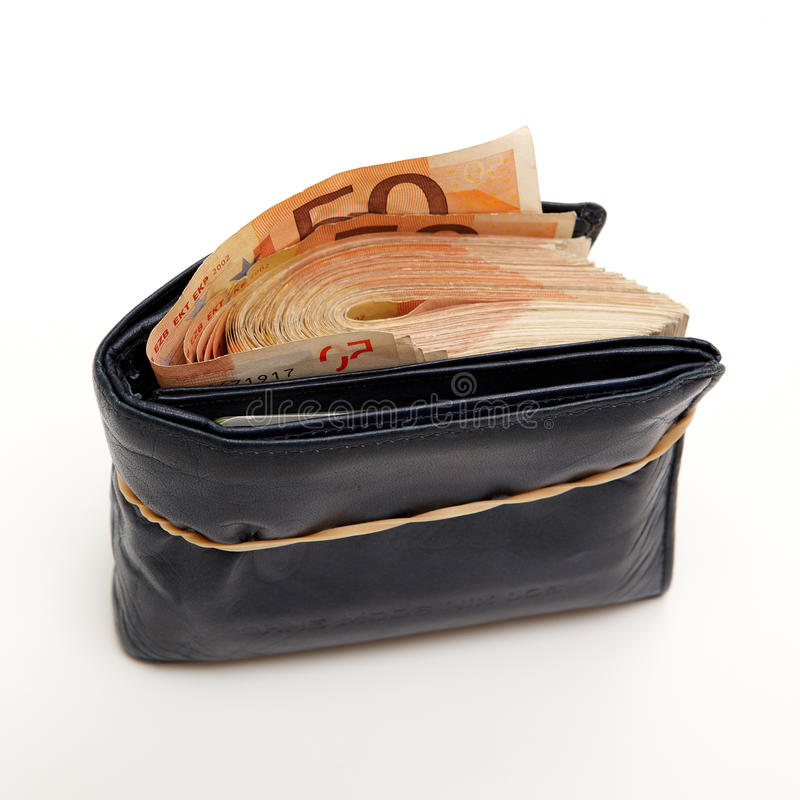 Wealth wallet. Wallet full of money tied with a rubber band stock images