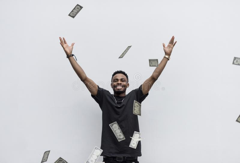 A wealthy African man throwing away his money royalty free stock images