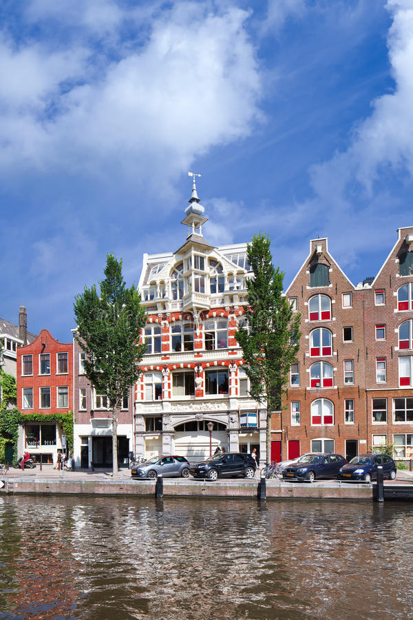 Wealthy ancient mansion in Amsterdam canal belt, Netherlands. AMSTERDAM-AUGUST 27, 2014. Wealthy ancient mansion in Amsterdam canal belt. Amsterdam is known as stock photo