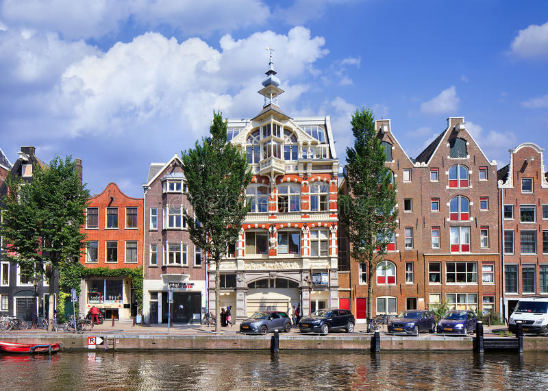Wealthy ancient mansion in Amsterdam canal belt, Netherlands. AMSTERDAM-AUGUST 27, 2014. Wealthy ancient mansion in Amsterdam canal belt. Amsterdam is known as royalty free stock photo