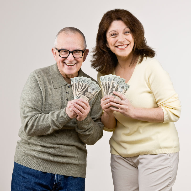 Wealthy friends holding group of twenty dollar royalty free stock image