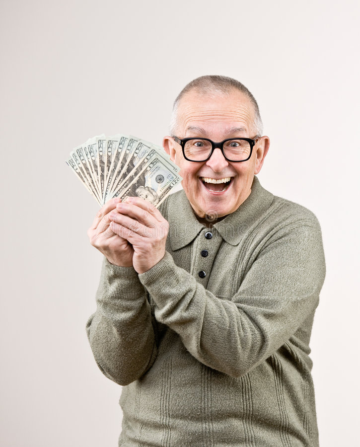 Wealthy man holding group of twenty dollar bill royalty free stock photos