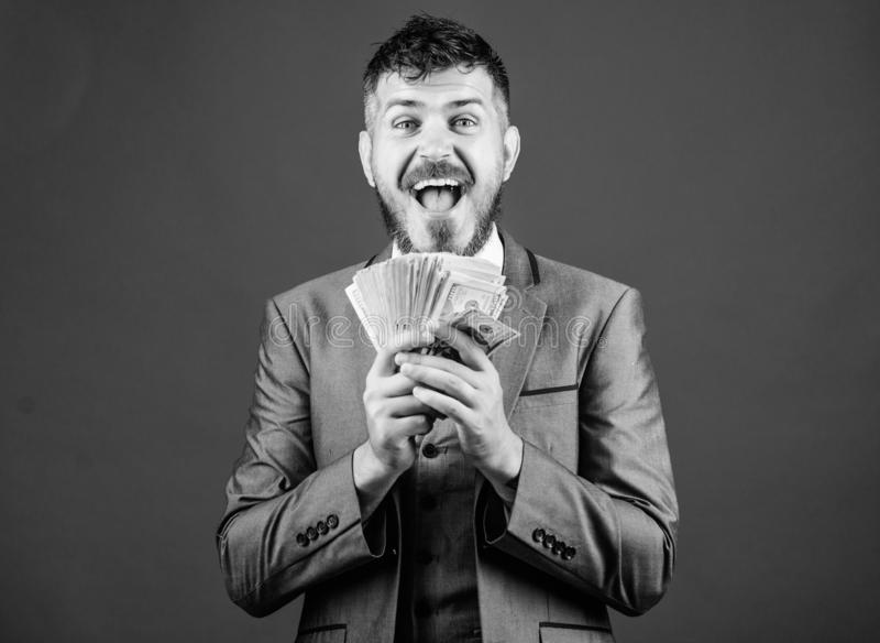 Wealthy and successful. Making money with his own business. Business startup loan. Bearded man holding cash money. Rich. Businessman with us dollars banknotes stock images