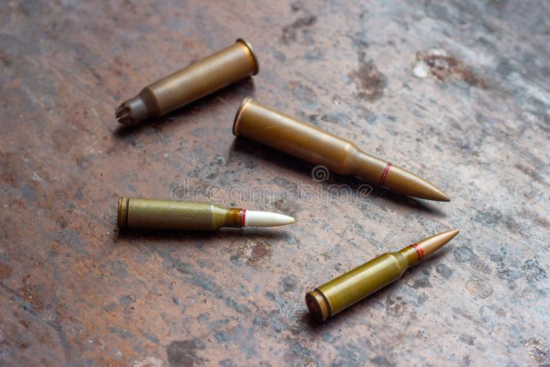 Weapon bullets on rusty metal background. Military industry, war, global arms trade and crime concept. Weapon bullets on rusty metal background. Military royalty free stock images