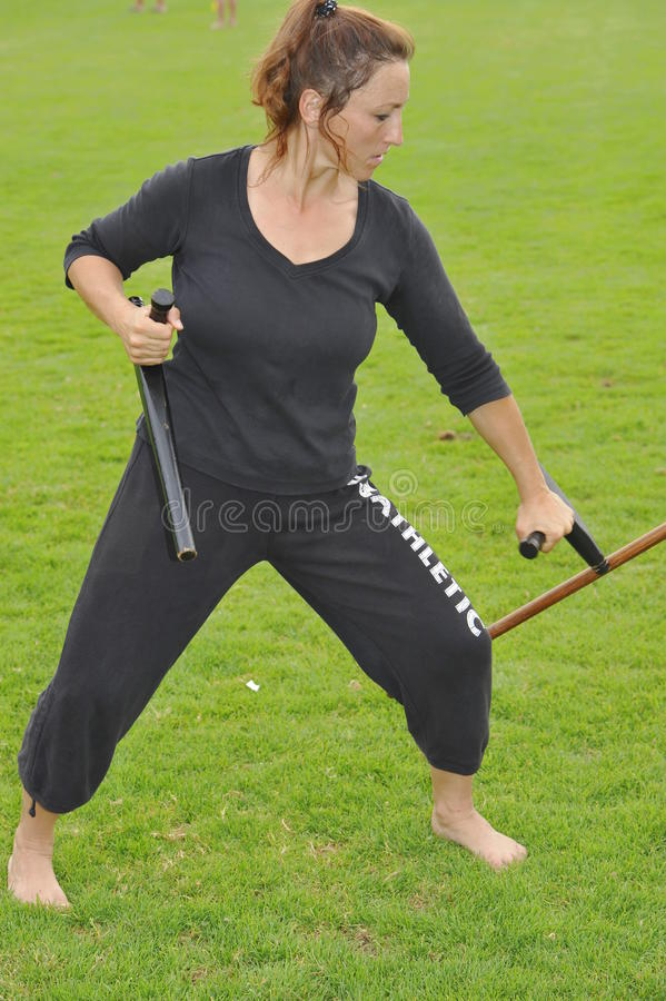 Weapon Karate With Tonfa Editorial Stock Image