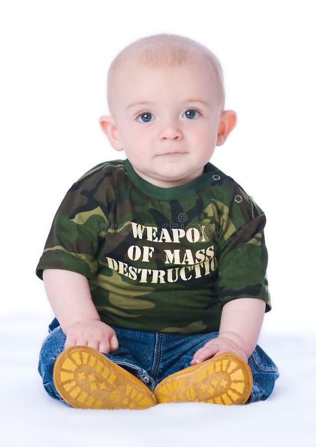 Weapon of mass destruction. Small boy wearing a weapon of mass destruction t-shirt stock photography