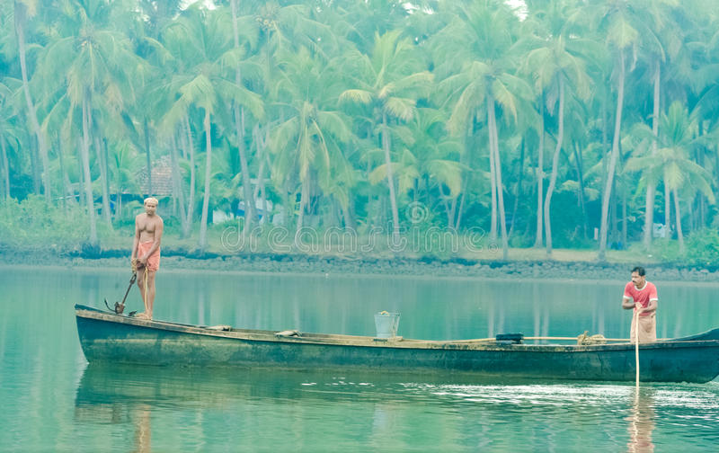 Weapon. Two guys are fishing in back water, an usual scene from Kerala stock photos