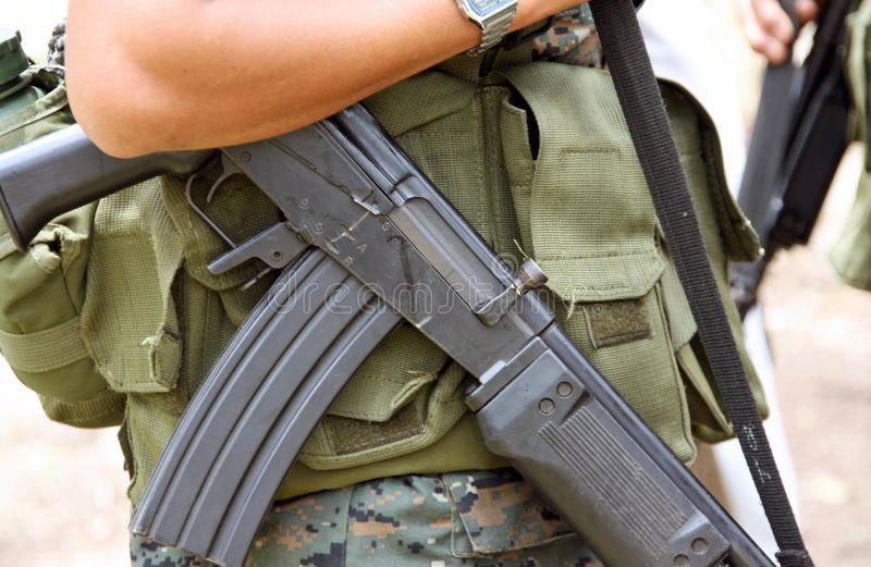 Weapon of war. Focus on weapon of war carried by a military from Guatemala royalty free stock photography
